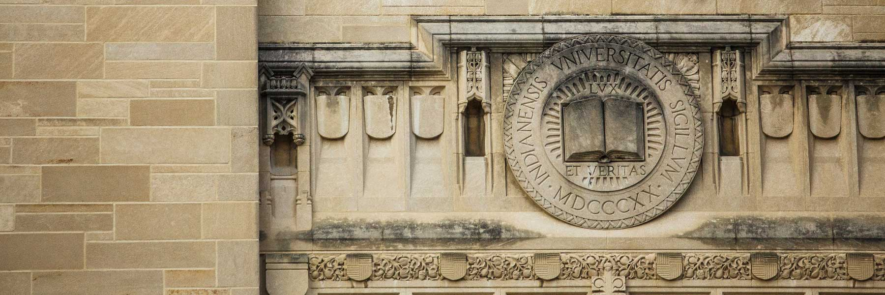 The Indiana University seal carved in limestone on the Indiana Memorial Union building