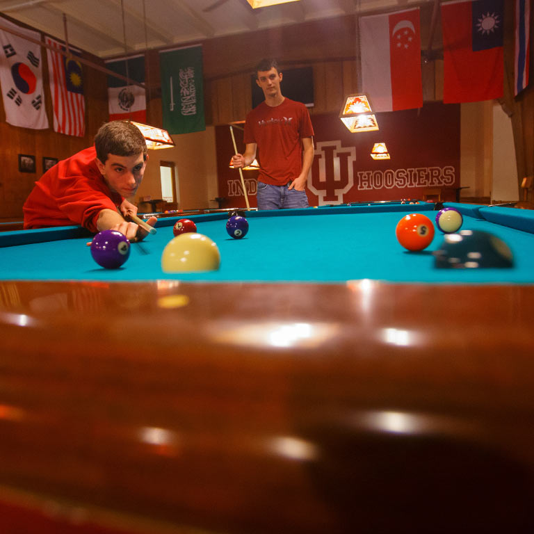 Two students play pool at Bowling and Billiards in the Indiana Memorial Union.