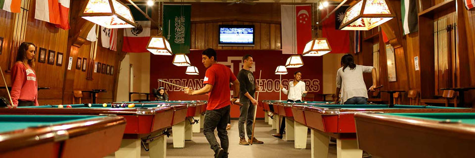 Students play pool at Bowling and Billiards in the Indiana Memorial Union.