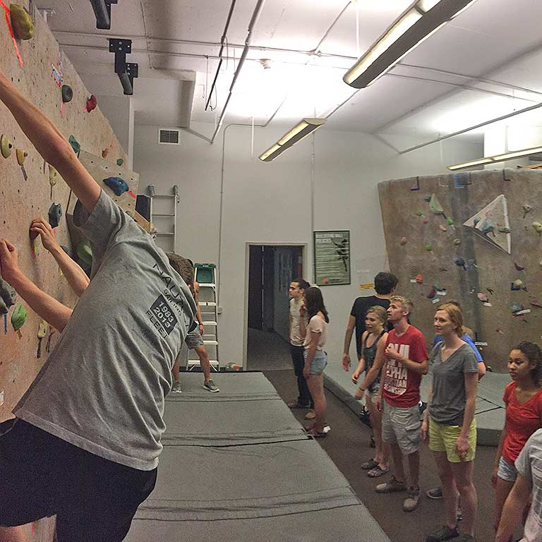 Students climb the IU Outdoor Adventures bouldering wall.