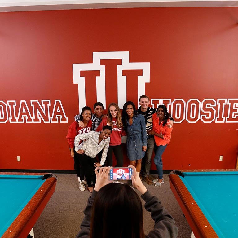 A group of students poses for a photo at Bowling and Billiards in the Indiana Memorial Union.