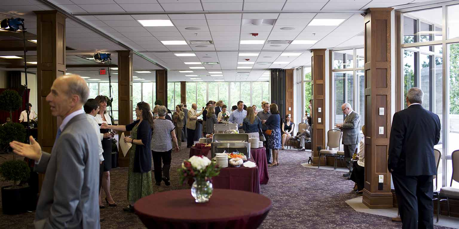 Guests enjoy a buffet lunch at an event in the Solarium in the Indiana Memorial Union.