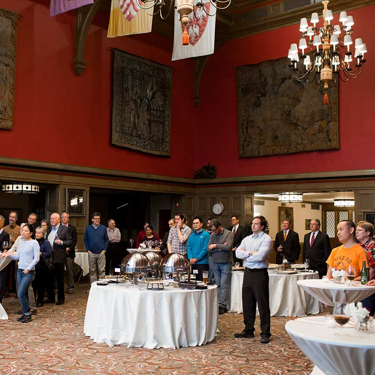 Guests attend a reception in the Tudor Room in the Indiana Memorial Union.