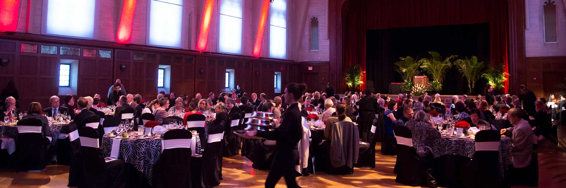 Guests attend a formal event at Alumni Hall in the Indiana Memorial Union.