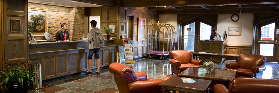 A guest checks in at the Biddle Hotel in the Indiana Memorial Union.