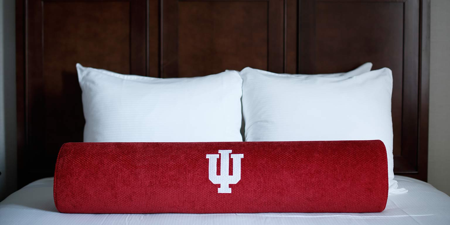 An IU pillow rests on the bed in a room at the Biddle Hotel.