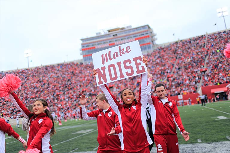 Cheerleaders cheer at an Indiana University football game at Memorial Stadium.